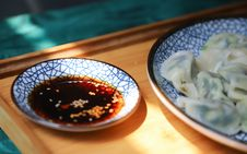 Free Round Blue Saucer Filled With Soy Sauce Stock Image - 126193231