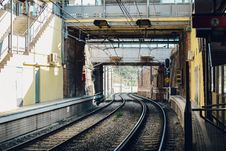 Free Gray Train Rail Under Yellow And Gray Building Royalty Free Stock Photography - 126193257