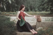 Free Woman Sitting On Star Beside Brown Wicker Basket Durng Daytime Stock Images - 126193424