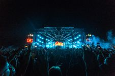Free Crowd In Front Of Blue And Orange Stage During A Concert At Night Stock Photo - 126193490