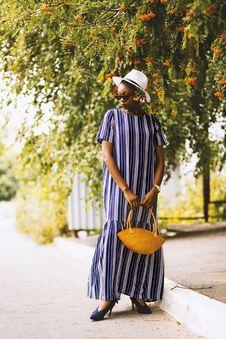 Free Woman Wearing Dress Holding Basket Stock Photo - 126193520
