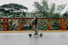 Free Man Riding On Bird Electric Scooter Royalty Free Stock Photo - 126193545