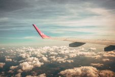 Free Aerial Photography Of Airplane Wing Over Clouds Stock Photography - 126193682