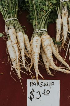 Free Parsnips On Red Surface Stock Photo - 126193810