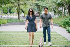 Free Couple Walking With Dog On Green Grass Royalty Free Stock Image - 126193836