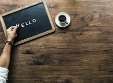 Free Hello Text On Mini Chalkboard Beside Cup Of Coffee Stock Images - 126194094