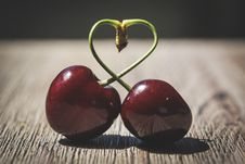 Free Two Red Cherries On Brown Surface Royalty Free Stock Image - 126194106