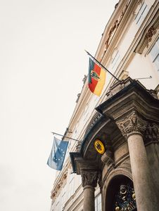Free Two Flags Hanging On A Building Stock Image - 126194161