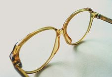 Free Yellow Frame Eyeglasses On White Surface Royalty Free Stock Photography - 126194167
