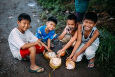 Free Four Boys Holding Coconut Shell Royalty Free Stock Images - 126194199
