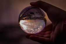 Free Selective Focus Photography Of Person Holding Glass Ball Stock Photography - 126194212