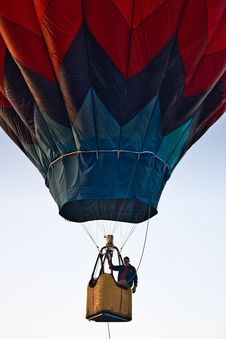 Free Man Riding Blue And Red Hot Air Balloon During Day Royalty Free Stock Photos - 126194358