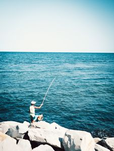 Free Two Boys Fishing While Standing On Boulder Royalty Free Stock Images - 126194409