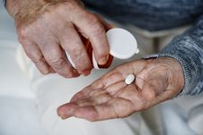 Free Person Holding White Medication Tablet Royalty Free Stock Photos - 126194468