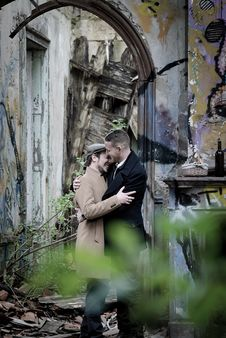 Free Man Embracing Man Near Gray Wall Royalty Free Stock Photo - 126194515