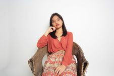Free Woman Sitting On Brown Wicker Armchair Stock Image - 126194591