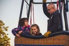 Free Man And Two Girls Riding On Hot Air Balloon Stock Photo - 126194620