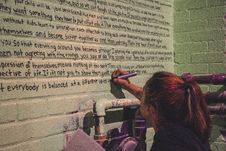 Free Woman Holding Marker Writing On Wall Stock Image - 126194631