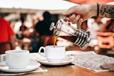 Free Person Pouring Coffee On White Ceramic Cup Stock Photography - 126194662
