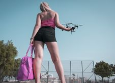 Free Woman Standing While Holding Quadcopter Drone Stock Photo - 126194890