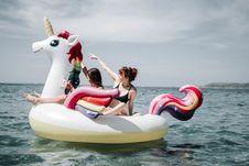 Free Two Women On Unicorn Floater On Sea Stock Image - 126194981