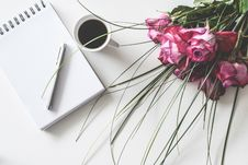 Free Red Rose Flowers Bouquet On White Surface Beside Spring Book With Click Pen And Cup Of Cofffee Royalty Free Stock Photography - 126195067