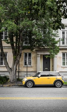 Free Yellow Mini Cooper Parked Beside White Concrete Building Royalty Free Stock Photos - 126195158