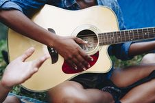 Free Photo Of Person Playing Guitar Stock Photography - 126195382