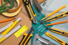 Free Assorted-type-and-size Utility Cutters On Clear And Green Olfa Measuring Tool Near Adhesive Tape Rolls Stock Image - 126195401