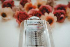 Free Aqua Carpalica Bottle Near Flowers On White Surface Royalty Free Stock Photos - 126195518