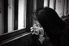 Free Grayscale Photo Of Woman Taking Photo Beside Window Stock Image - 126195561