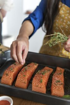 Free Photography Of Person Putting Herbs On Salmon Royalty Free Stock Photo - 126195585