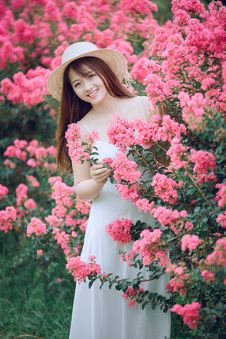 Free Woman Behind Pink Flowers Royalty Free Stock Images - 126195619