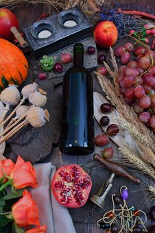 Free Wine Bottle Surrounded With Vegetables And Fruit On Brown Wooden Surface Royalty Free Stock Images - 126195629