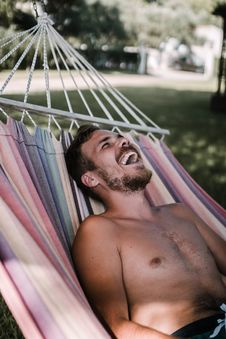 Free Laughing Man Laying On Hammock Stock Photos - 126195643