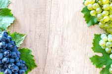 Free Blue Berries And Green Grapes On Beige Wooden Surface Royalty Free Stock Photo - 126195765