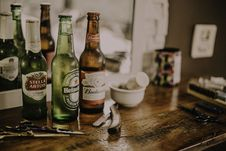 Free Three Assorted Beverage Bottles On Brown Wooden Table Royalty Free Stock Photography - 126195777