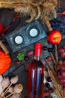 Free Gray Candle Holder Near Glass Bottle And Round Red Fruit On Gray Wooden Surface Royalty Free Stock Image - 126195806
