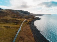 Free Aerial Photo Of Road Near Sea Water Stock Photos - 126196023