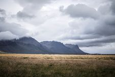 Free Brown Grass Field And Gray Mountains Under Gray Clouds Stock Images - 126196304