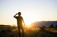 Free Man Standing On Grass Field Overlooking Sunrise Royalty Free Stock Images - 126196769