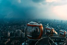 Free Aerial View Of Red-and-white Enclosed Rides Overlooking City Stock Photography - 126245562