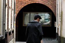 Free Man On Narrow Pathway Between Concrete Buildings Stock Image - 126245601
