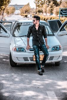 Free Man Sitting On White Car Hood Stock Photo - 126245790