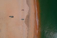 Free Aerial Photography Of Two Gray Wooden Boats On Sand Front Of Sea Stock Photo - 126246210