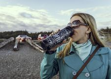 Free Woman Drinking From Bottle Royalty Free Stock Photos - 126246238
