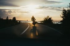 Free Person Riding Motorcycle During Golden Hour Royalty Free Stock Images - 126246279