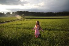 Free Girl Running On Green Grass Field Near Open Road Stock Photography - 126246312