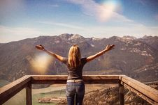 Free Woman Facing Mountains Raising Her Hands Stock Photos - 126246653