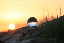 Free Photography Of Glass Ball On Brown Rock Formation During Sunset Stock Image - 126404491